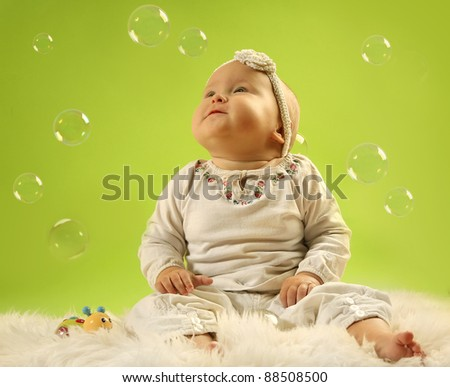 cute little baby on green background