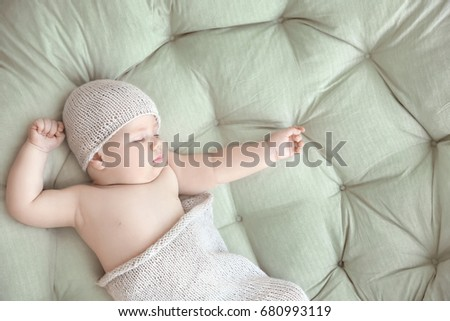Cute little baby sleeping on lounge at home #680993119