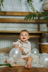 Cute little baby toddler princess at first birthday party at home. 1st Birthday home party ideas with natural decoration. Sustainable eco-friendly baby birthday at home