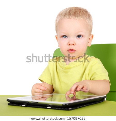 cute little baby with the tablet PC