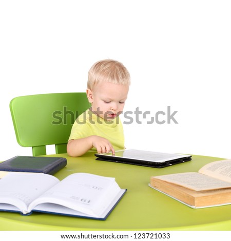 cute little baby with the tablet PC, books and diary