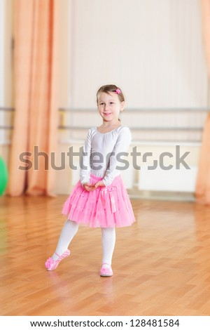 Cute little ballet dancer at training class
