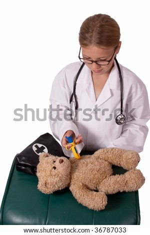 Cute little blond girl dressed up like a doctor holding a pretend needle and a brown teddy bear smiling