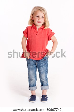 Cute little blonde girl in jeans and a red polo shirt