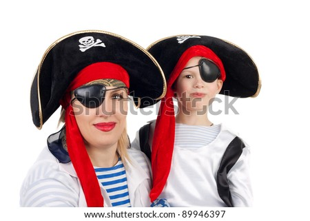 cute little boy and his pretty young mother in the pirate costumes