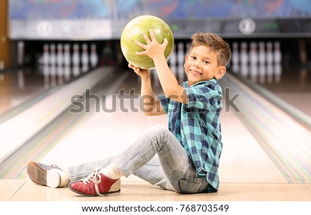 Cute little boy at bowling club