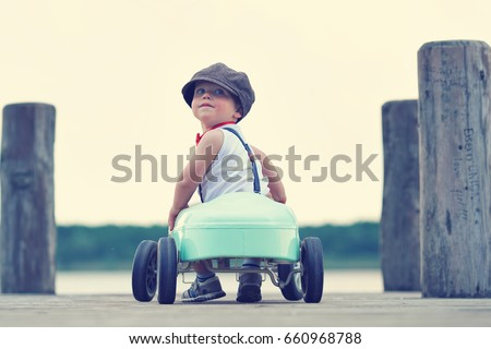 cute little boy driving pedal...