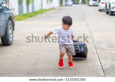 Cute little boy having fun and going on vacations trip with suitcase. Vacation with child. Copy space #1510301585