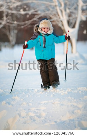 Cute little boy having fun during skiing on cross