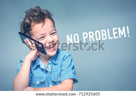 Cute little boy in a blue shirt talking on the phone next to inscription 'NO PROBLEM' Сток-фото ©