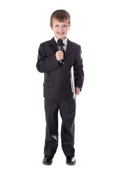 cute little boy in business suit with microphone isolated on white background