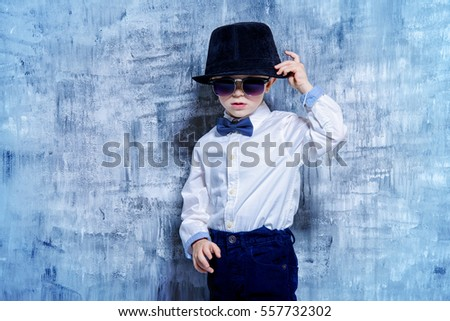 aa34c59e6 Cute little boy in elegant clothes and sunglasses. Be like daddy. Kid's  fashion.
