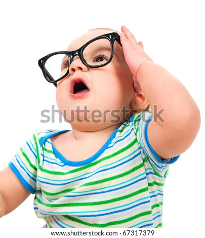 Cute little boy in glasses on white background
