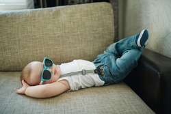 cute little boy in sunglasses at home