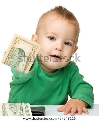 Cute little boy is counting money, isolated over white