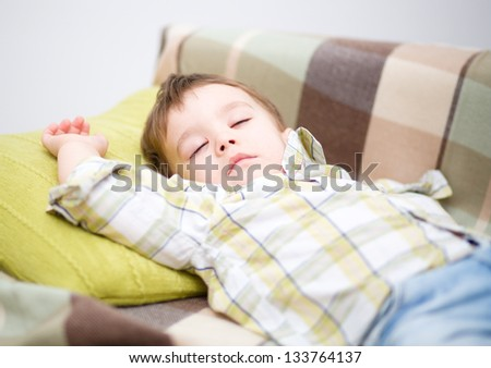 Cute little boy is sleeping