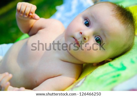 Cute little boy lying outdoors in the park