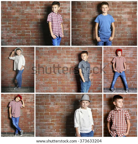 cute little boy on brick wall...