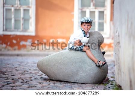 Cute little boy outdoors in city