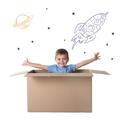 Cute little boy playing in cardboard box on white background with illustrations