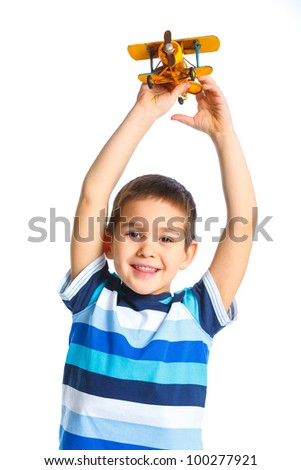 Cute little boy playing with a toy airplane. Isolated on white background - stock photo
