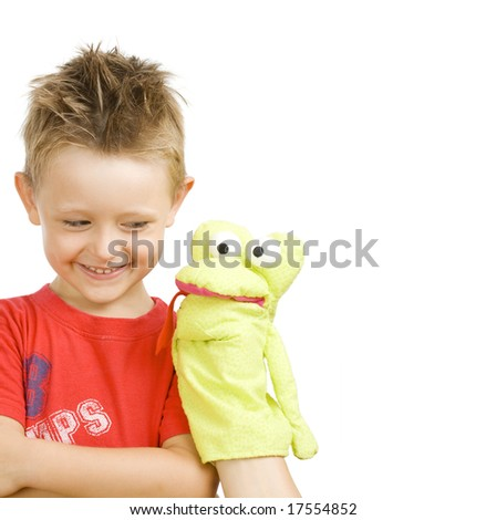 cute little boy playing with snake puppet