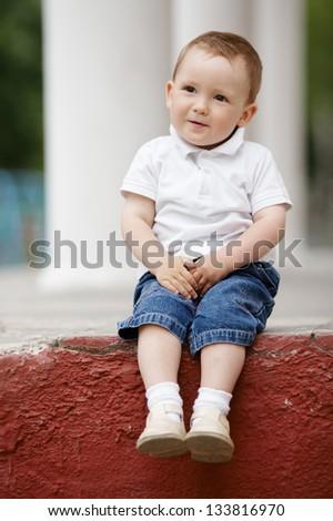 cute little boy portrait outdoors