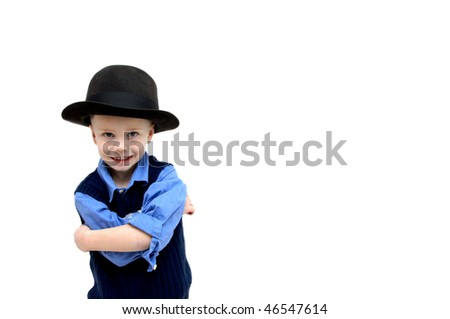 Cute little boy poses with an antique derby felt hat.  His arms are crossed and he is sporting an attitude.  Child poses in corner with blank area left for personalization.