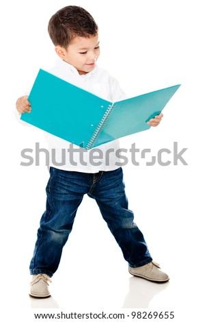 Cute little boy reading a book - isolated over a white background