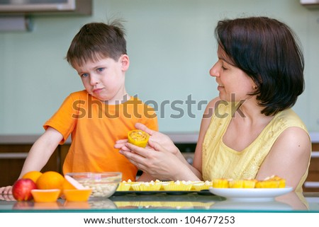 Cute little boy refuses to taste muffin