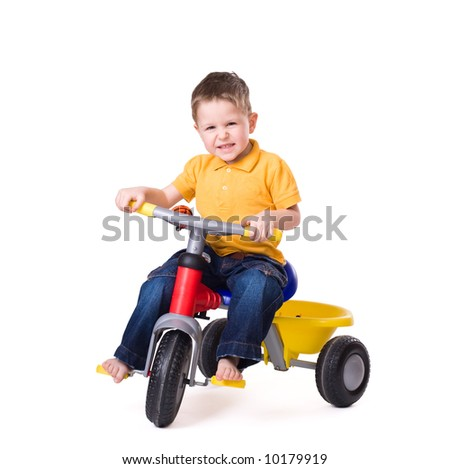 Cute little boy riding a 3-wheel bike. Isolated on white background - stock photo