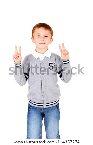 cute little boy showing the victory sign with his hands
