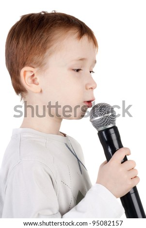 cute little boy singing with the microphone