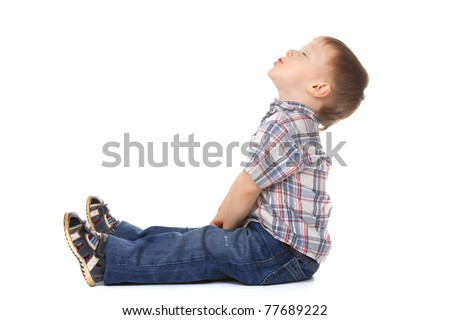 Cute little boy sitting look up to empty copy space isolated on white background. concept.