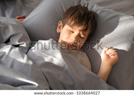 Cute little boy sleeping in bed at home #1038664027