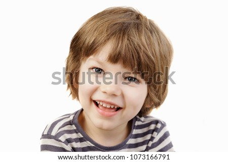 Cute little boy smiling at the camera #1073166791