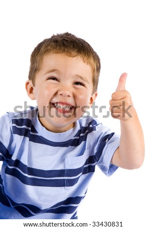 Cute little boy with a thumbs up