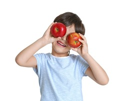 Cute little boy with apples on white background