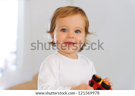 Cute little boy with blue eyes portrait