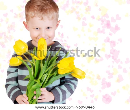 Cute little boy with bouquet of yellow tulips for gift