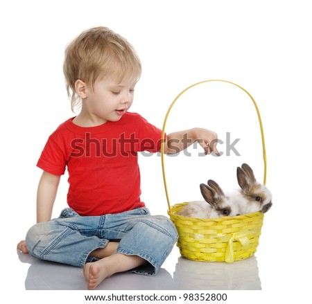 Cute little boy with Easter rabbit in yellow basket. isolated on white background