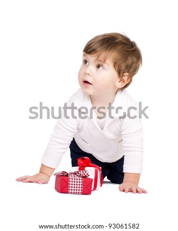 Cute little boy with gift boxes. Isolated on white.