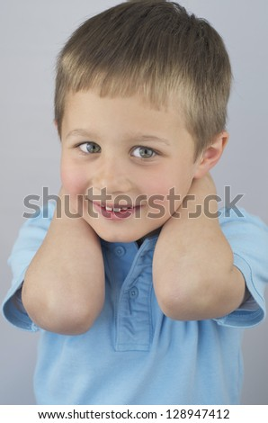 Cute Little Boy With Hands Behind His Head, Smiling