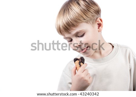 cute little boy with ice-cream in the hand isolated over white - stock photo