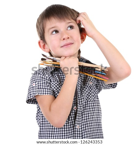 Cute little boy with paintbrushes isolated on white