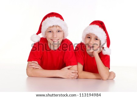 cute little brothers in santa hats lying