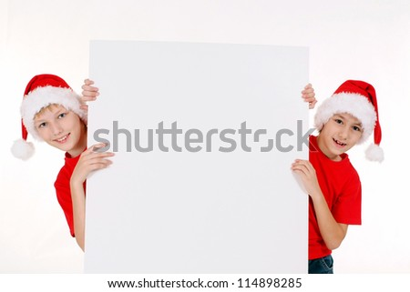 cute little brothers in santa hats with board
