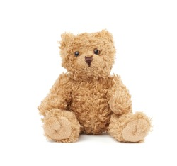 cute little brown teddy bear, toy is sitting on a white background, close up