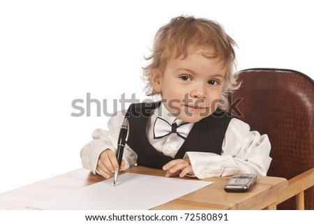 Cute little businessman is signing a contract
