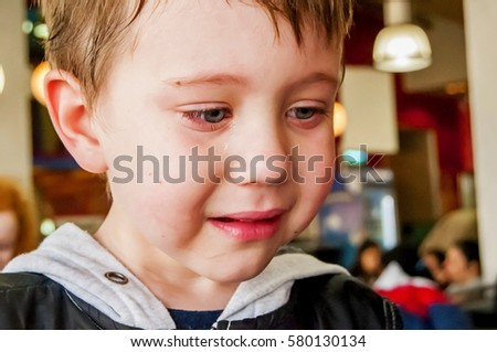 Cute little Caucasian boy crying close up. Poor child behavior, upbringing problems, upset child, baby breed, pedagogy, frustrated boy, depressed, care, emotional, emotion, emotive, fear, problem #580130134